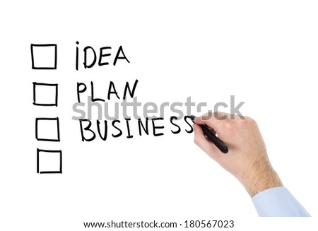 A hand writing business plan.