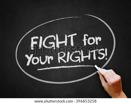 A hand writing 'Fight for Your Rights' on chalkboard. - stock photo