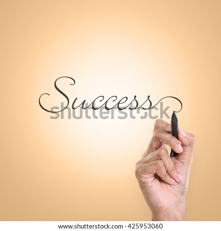 "A hand writing inscription of ""Success"" in an elegant cursive lettering"
