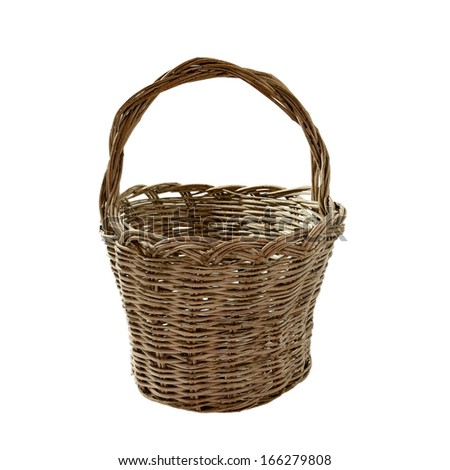 a handcrafted homemade basket made of olive twigs isolated on a white background - stock photo