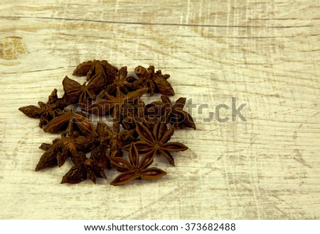 A handful of aniseed-flavored stars on an old, bright, wooden countertop kitchen-style vintage.Wolne place for text on the right side of the frame. Close, horizontal view. - stock photo