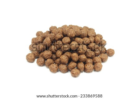 a handful of beads coated with chocolate on a white background