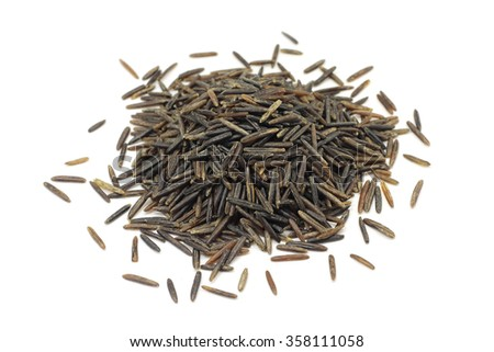 a handful of grain wild rice on a white background