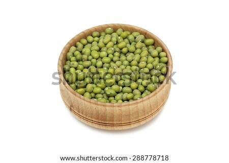 a handful of green mung bean in a wooden bowl on a white background - stock photo
