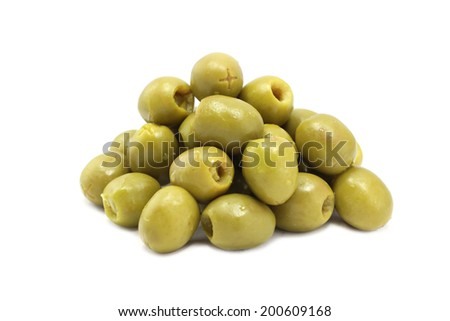 a handful of green olives on white background  - stock photo