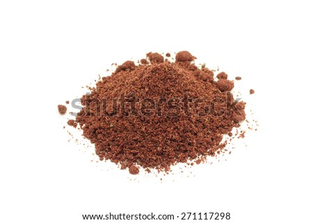 a handful of red sumac powder abstract background