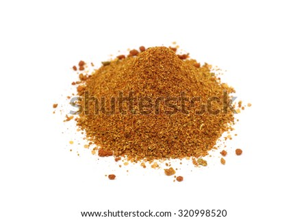 a handful of spice mix for meat on a white background