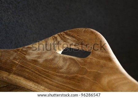 A handle of a wooden tray