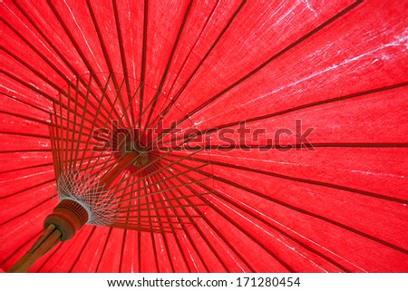 A handmade red, Chiangmai Thailand parasol or umbrella