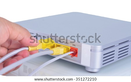 a hands being infused into the modem cable wire.  - stock photo
