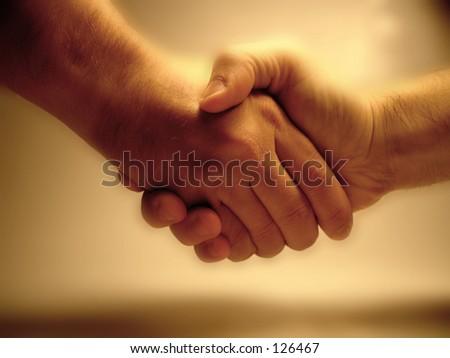 A handshake. - stock photo