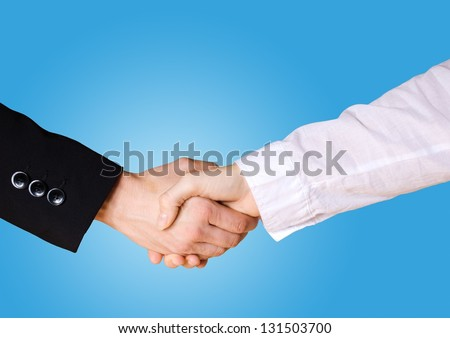 a handshake between two people in business cloth with blue background