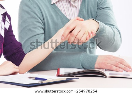 a handshake in office - stock photo