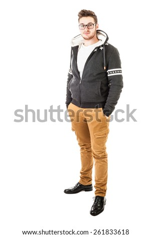 a handsome and fashionable  young man with trendy clothes isolated over a white background - stock photo