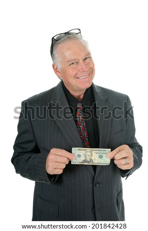 A Handsome and Friendly Father or Business Man holds out money as if he is going to give you your allowance, financial loan or gift of spending money. Dads around the world Lovingly give money freely. - stock photo