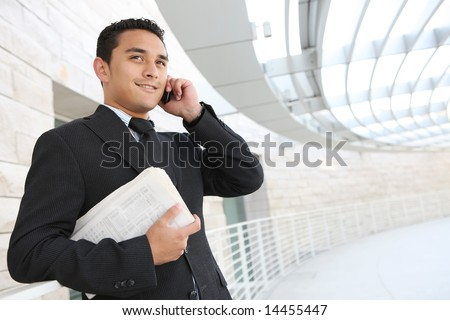 A handsome business man at his company office building - stock photo