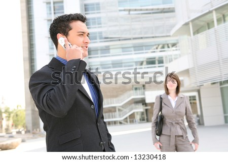 A handsome business man at office building on the cell phone - stock photo