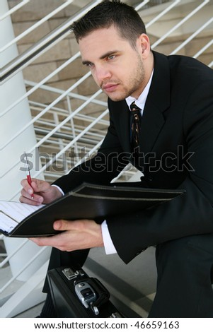 A handsome business man at the office with notebook