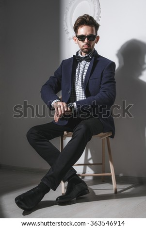 A handsome business man in an elegant suit and glasses - stock photo