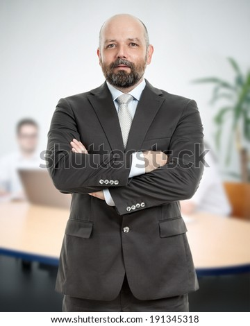 A handsome business man in the office - stock photo