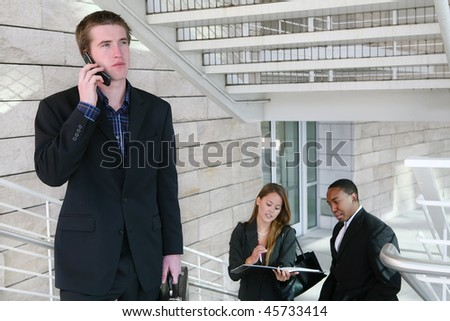 A handsome business man on phone at place of work