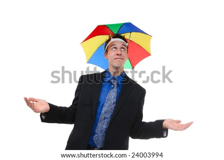 A handsome business man under a rainbow hat umbrella