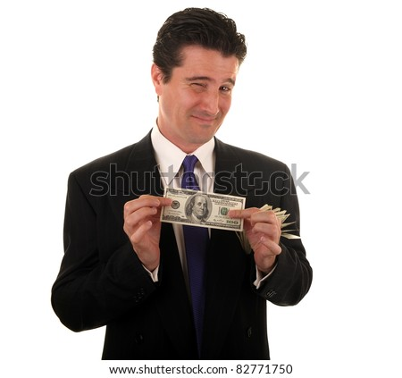 A handsome businessman in a suit holds bills he is saving for retirement. - stock photo