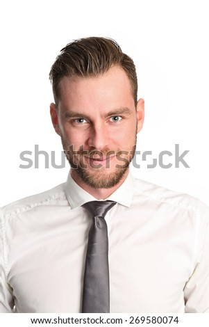 A handsome businessman wearing a white shirt and grey tie. Standing in a studio. White background. - stock photo