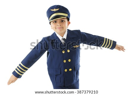 "A handsome elementary ""airline pilot"" pretending to be an airplane in his pilot uniform.  On a white background. - stock photo"