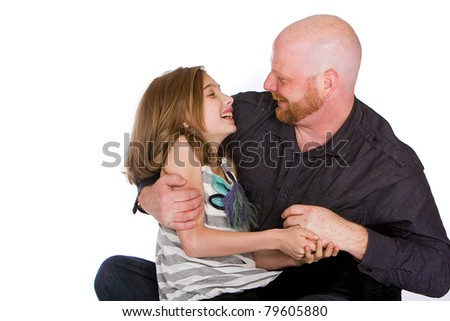 A handsome Father and his cute daughter in front of an isolated white background.