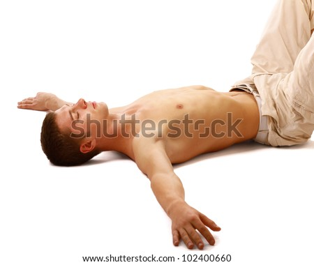 A handsome guy lying on the floor - stock photo