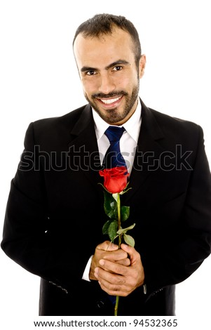 A handsome latin man holding a  rose