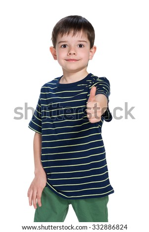 A handsome little boy holds his thumb up - stock photo
