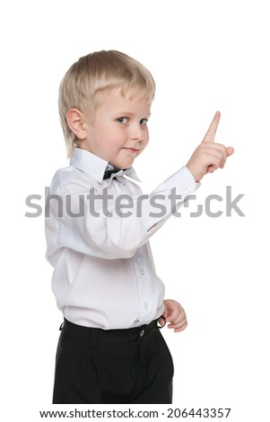 A handsome little boy shows his finger up on the white background