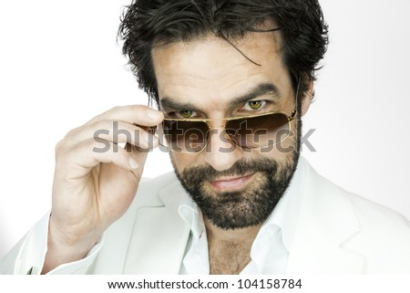A handsome man with a beard and sun glasses - stock photo