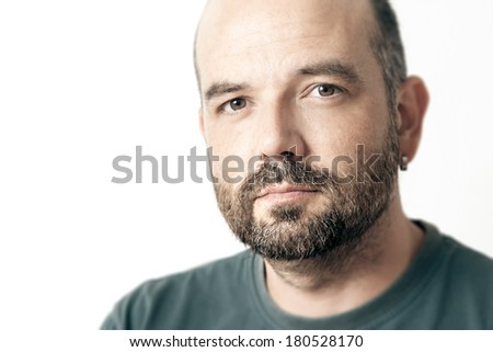 A handsome man with a beard isolated on white background - stock photo