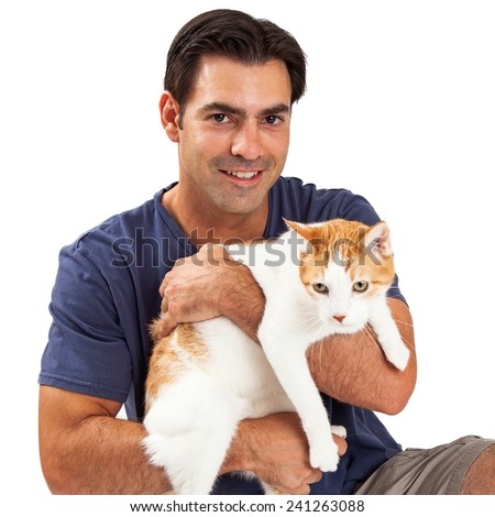 A handsome man with dark hair holding an orange and white cat
