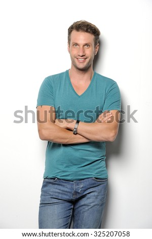 A handsome mature man smiling at the camera against a white background