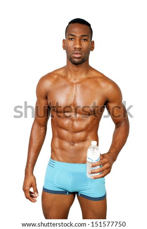 A handsome, muscular black make athlete, holding a bottle of water, isolated on a white background with generous copyspace. - stock photo