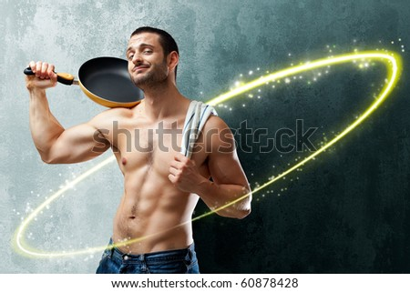 A handsome muscular cook posing with a pan on his shoulder into a circle of shining lights