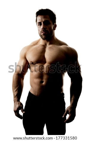 A handsome muscular sports man hard lit with deep shadows isolated on a white background - stock photo