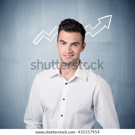 A handsome sales guy standing in front of a blue urban concrete wall with illustration of white graph chart arrows concept - stock photo