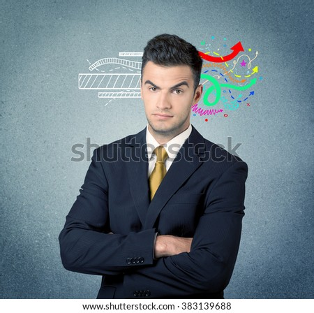 A handsome sales person standing in front of a blue  urban concrete wall with illustration expressing creativity by transforming white lines to colorful arrows cocncept - stock photo