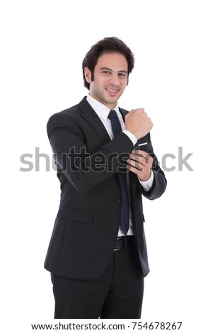 A Handsome smiling man doing up his formal suit. Isolated on white background.