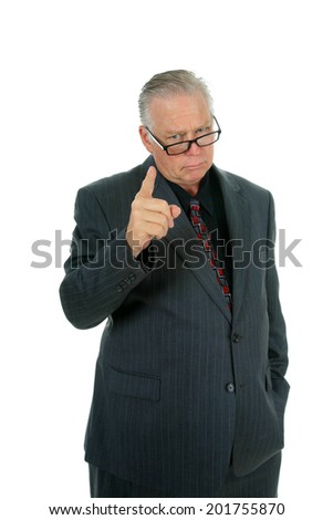 A handsome well dressed fatherly business man looks over his reading glasses and shakes his finger in disapproval at something someone has done or is about to do.  Isolated on white with room text  - stock photo