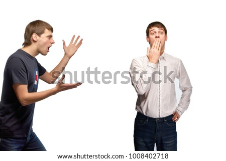 A handsome young guy screams to himself. Very angry and aggressive guy in casual clothes, in a T-shirt and jeans. The manager, the worker was mistaken, guilty. The businessman was disgraced.
