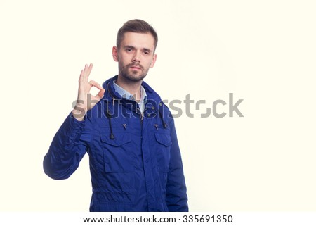A handsome young guy telling you everything is OK while isolated on a white background - stock photo