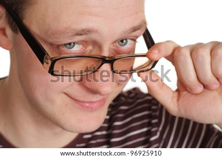 A handsome young man holding the glasses on a white background