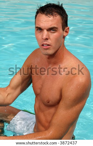 A handsome young man in a swimming pool