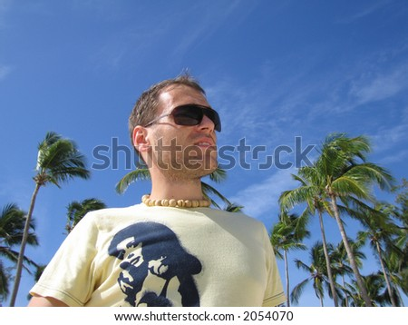 A handsome young man in a tropic environment.